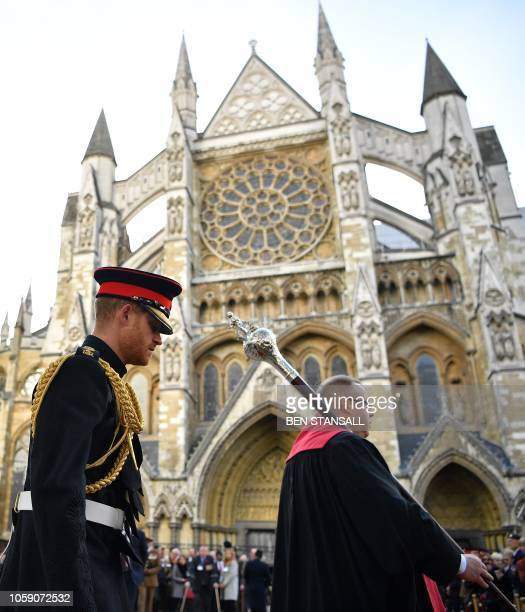 Britain's Prince Harry Duke of Sussex walks to view the Field of Remembrance at Westminster Abbey in central London on November 8 2018 In the runup...