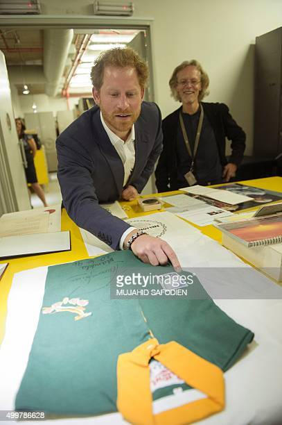 Britain's Prince Harry examines 1995 Rugby World Cup jersey gifted from South African rugby player Francois Pienaard to Nelson Mandela at the Center...