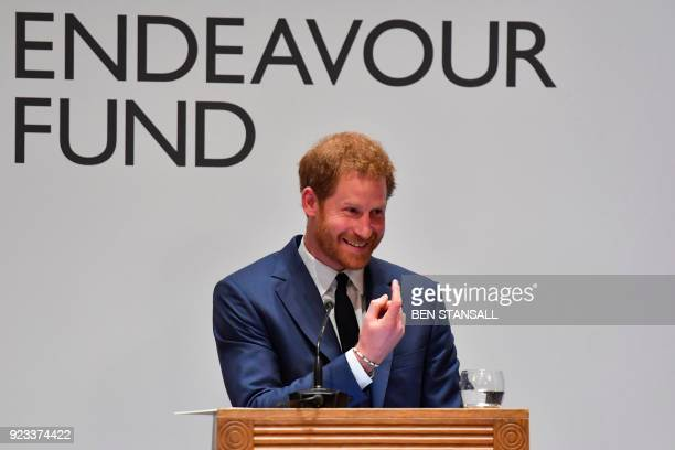 Britain's Prince Harry gestures as he annouces the winner of the Henry Worsley Award during the annual Endeavour Fund Awards at Goldsmiths' Hall in...