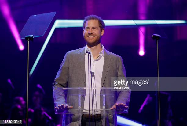 Britain's Prince Harry gives a speech on stage before announcing the winners of the Health and Wellbeing category at the inaugural OnSide Awards at...