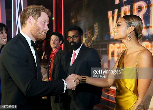 Britain's Prince Harry greets Alesha Dixon after the Royal Variety Performance at the Albert Hall on November 13 2015 in London England