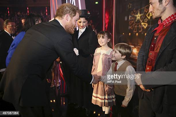 Britain's Prince Harry greets cast members of Mary Poppins after the Royal Variety Performance at the Albert Hall on November 13 2015 in London...