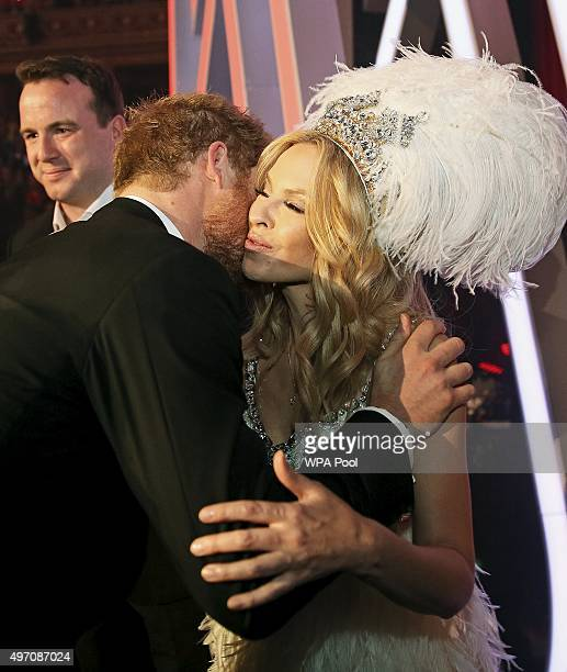 Britain's Prince Harry greets Kylie Minogue after the Royal Variety Performance at the Albert Hall on November 13 2015 in London England
