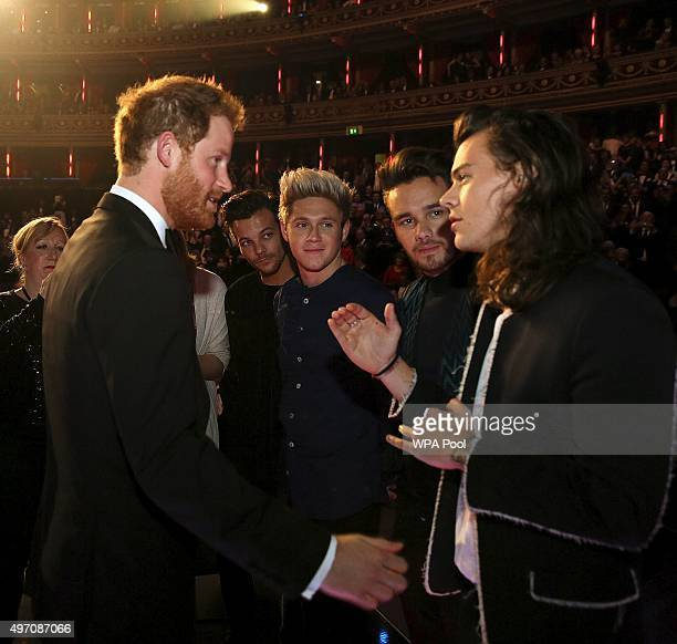 Britain's Prince Harry greets members of One Direction after the Royal Variety Performance at the Albert Hall on November 13 2015 in London England