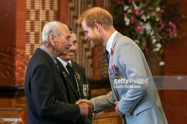 Britain's Prince Harry greets Robert Gillies the last surviving member of `B` Company 28th Maori Battalion and Bryce Morrison the Rotorua RSA...