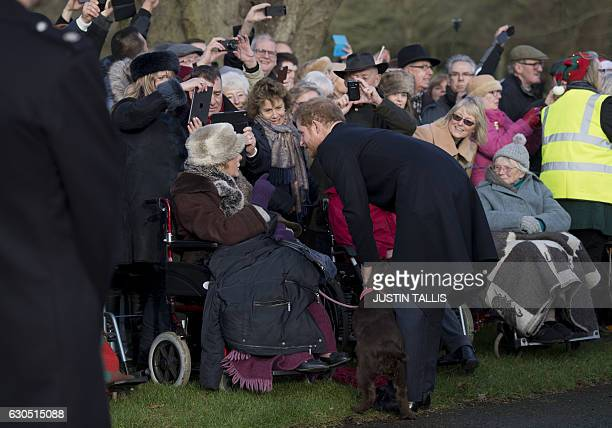 Britain's Prince Harry greets wellwishers after attending a Christmas Day church service at St Mary Magdalene Church in Sandringham Norfolk eastern...