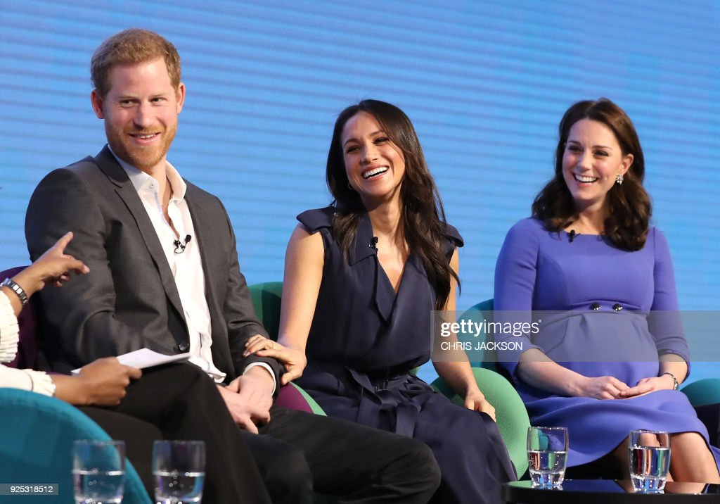 Britain's Prince Harry, his fiancee US actress Meghan Markle and Britain's Catherine, Duchess of Cambridge attend the first annual Royal Foundation Forum on February 28, 2018 in London. / AFP PHOTO / POOL / Chris Jackson