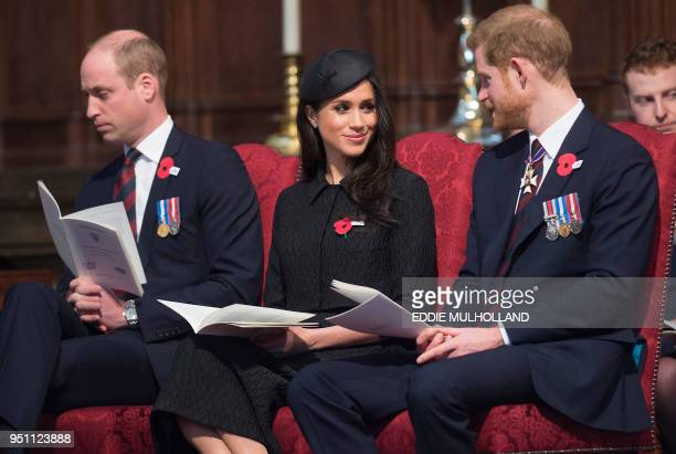 TOPSHOT Britain's Prince Harry his US fiancee Meghan Markle and Britain's Prince William Duke of Cambridge attend a service of commemoration and...