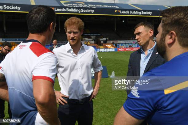 Britain's Prince Harry is accompanied by former Leeds Rhino rugby league player, Kevin Sinfield as he meets former England rugby league captain Paul...