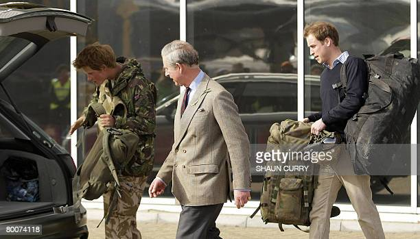 Britains Prince Harry is met by his brother Prince William and his father Prince Charles on his arrival at RAF Brize Norton in Oxforshire March 1...