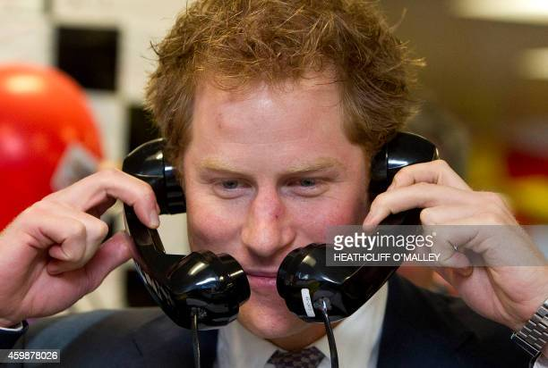 Britain's Prince Harry is pictured as he mans the telephones during the 22nd Annual ICAP Charity Day at the offices of ICAP brokers in central London...