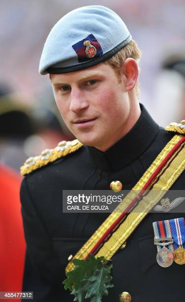 Britain's Prince Harry is pictured while reviewing the annual Founders Day Parade at the Royal Hospital Chelsea, in London, on June 9, 2011. The...