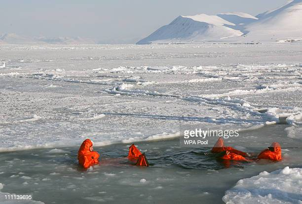 Britain's Prince Harry joining the Walking with the Wounded expedition team tries out an immersion suit on the island of Spitsbergen situated between...
