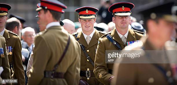 Britain's Prince Harry joins more than 200 sailors, soldiers and Royal Marines, and Airmen of 52 Infantry Brigade, as they parade along the Royal...