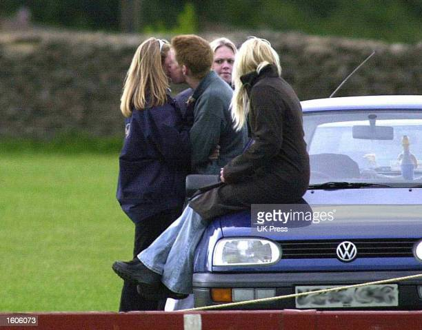 Britain''s Prince Harry kisses a friend June 9, 2001 at the Beaufort Polo Club near Tetbury in Gloucestershire, England.