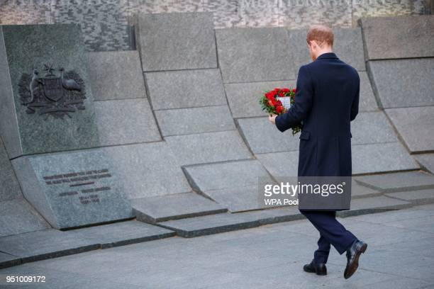 Britain's Prince Harry lays a wreath at the Australian War Memorial during an Anzac Day dawn service at Hyde Park Corner on April 25 2018 in London...
