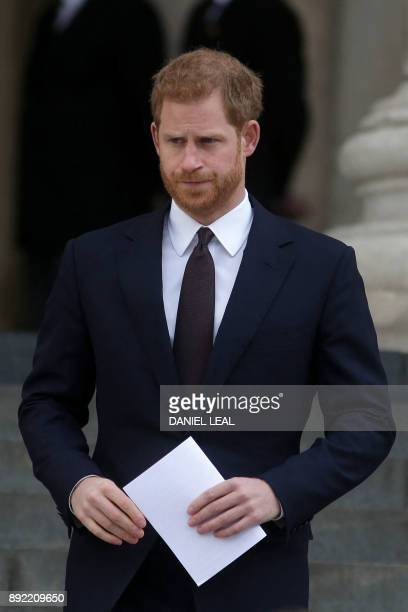 Britain's Prince Harry leaves after attending the Grenfell Tower National Memorial Service at St Paul's Cathedral in London on December 14 to mark...
