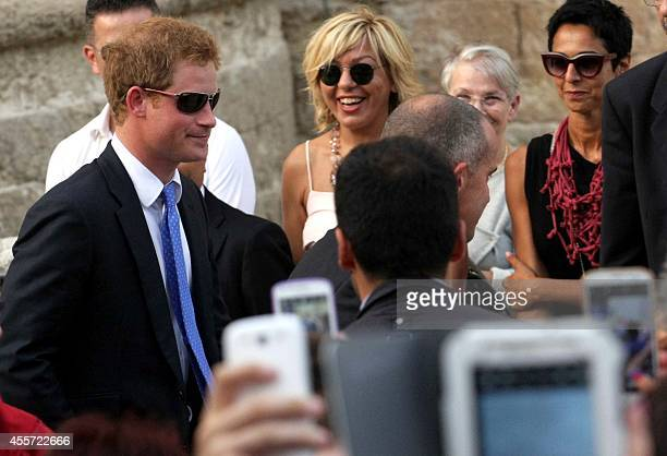 Britain's Prince Harry leaves at the end of the marriage of his friends Charlie Gilkes and Anneke von Trotha Taylor on September 19 2014 at the Carlo...