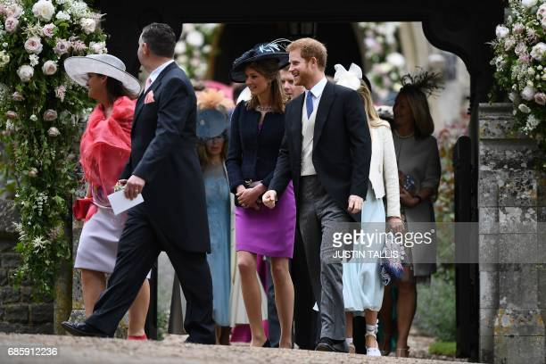 Britain's Prince Harry leaves St Mark's Church in Englefield, west of London, on May 20 after attending the wedding of Pippa Middleton to James...