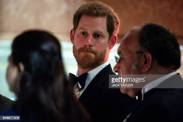 Britain's Prince Harry listens to speeches in the Picture Gallery at The Queen's Dinner during The Commonwealth Heads of Government Meeting at...
