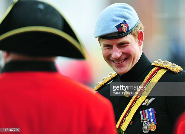 Britain's Prince Harry meets Chelsea Pensioners as he reviews the annual Founders Day Parade at the Royal Hospital Chelsea, in London, on June 9,...