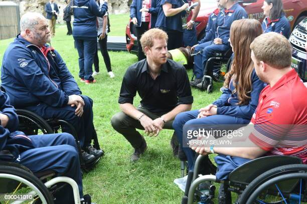 Britain's Prince Harry meets members of the team who will represent the United Kingdom at the Invictus games at the Tower of London in central London...