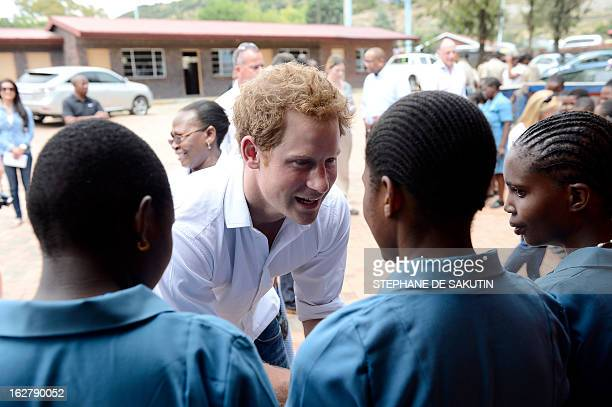 Britain's Prince Harry meets pupils at a primary school for blind children on February 27, 2013 in Maseru. The prince visited his charity projects in...
