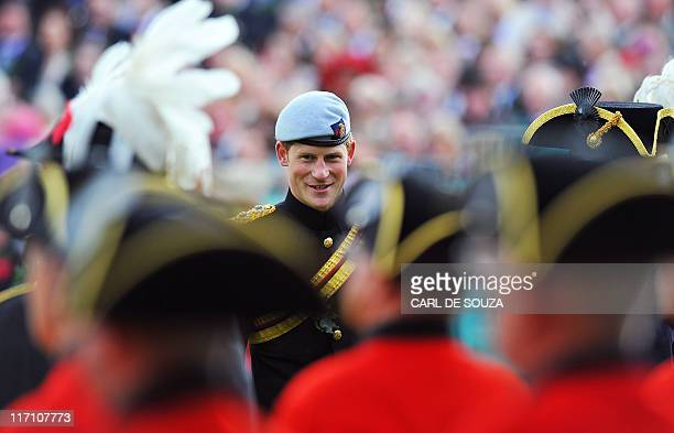 Britain's Prince Harry meets with Chelsea Pensioners as he reviews the annual Founders Day Parade at the Royal Hospital Chelsea, in London, on June...