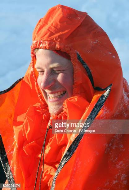 Britain's Prince Harry part of the Walking with the Wounded expedition team tries out an immersion suit on the island of Spitsbergen situated between...