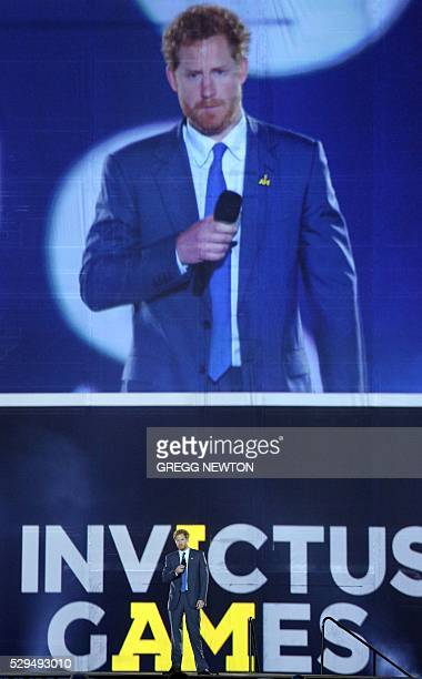 Britain's Prince Harry Patron of the Invictus Games Foundation delivers remarks during opening ceremonies for the 2016 Invictus Games in Orlando...