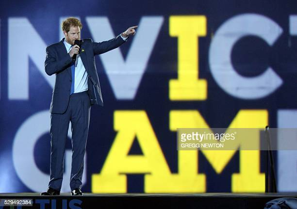 Britain's Prince Harry Patron of the Invictus Games Foundation delivers remarks during the opening ceremonies for the 2016 Invictus Games in Orlando...
