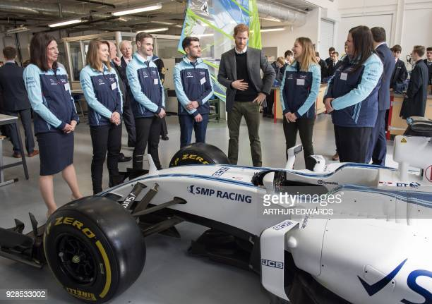 Britain's Prince Harry Patron of the Silverstone Experience talks to representatives from the Williams F1 Engineering Academy during a visit to the...