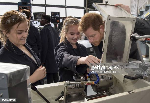 Britain's Prince Harry Patron of the Silverstone Experience talks to current students and alumni of the Silverstone University Technical College at...