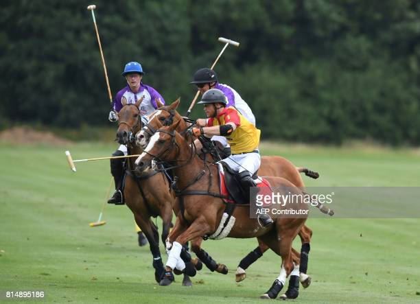 Britain's Prince Harry playing for Foxcote takes part in the Jerudong Park Trophy Final against CPPC at Cirencester Park Polo Club central England on...
