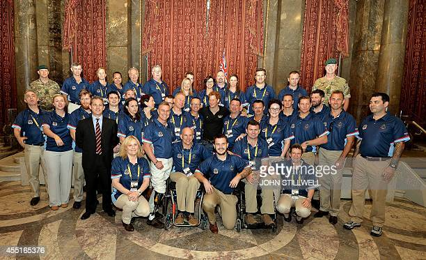 Britain's Prince Harry poses for a picture with the Australian Invictus team at Australia House in central London on September 10 ahead of the...