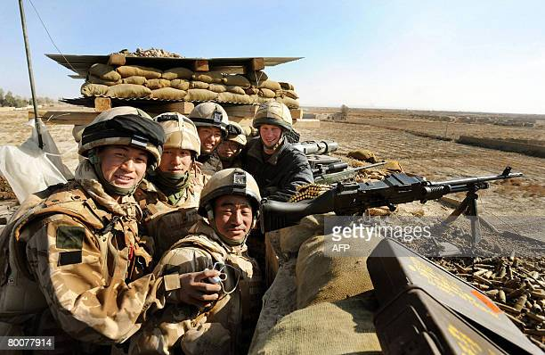 Britain's Prince Harry poses with Gurkha soldiers on January 2 2008 while at the observation post on JTAC Hill close to FOB Delhi in Helmand province...