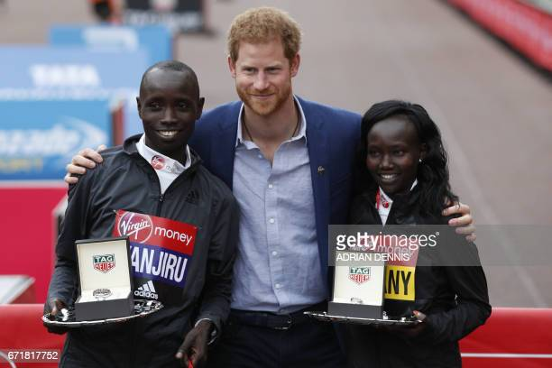 Britain's Prince Harry poses with Men's elite winner Kenya's Daniel Wanjiru and Women's elite winner Kenya's Mary Keitany after the London marathon...
