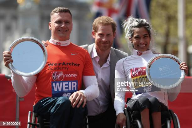 Britain's Prince Harry poses with the elite men's and women's wheelchair winners Britain's David Weir and Australia's Madison de Rozario at the 2018...