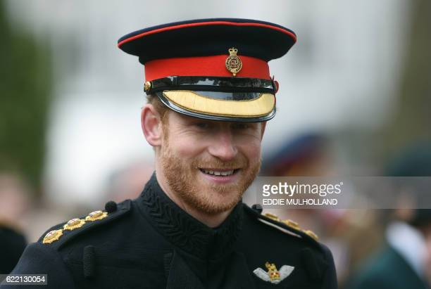 Britain's Prince Harry reacts as he visits the Field of Remembrance at Westminster Abbey in central London on November 10 2016 Prince Harry and his...