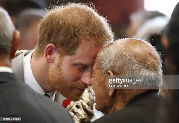 Britain's Prince Harry receives a hongi or traditional Maori greeting on a visit to Te Papaiouru marae in Rotorua on October 31 2018 The Duke and...