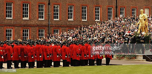 Britain's Prince Harry salutes Chelsea Pensioners as he reviews the annual Founders Day Parade at the Royal Hospital Chelsea, in London, on June 9,...