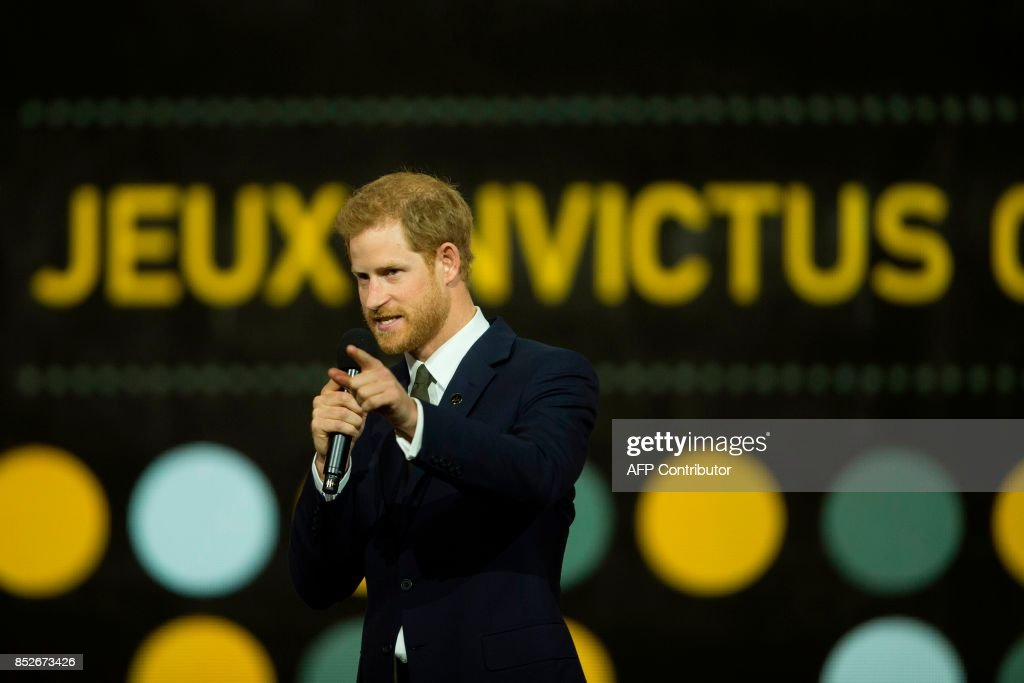 Britain's Prince Harry speaks during the opening ceremonies of the Invictus Games in Toronto, Ontario, September 23, 2017. / AFP PHOTO / Geoff Robins