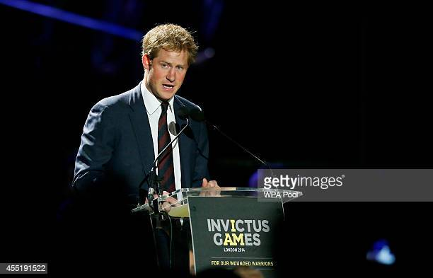 Britain's Prince Harry speaks during the opening ceremony for the Invictus Games which showcases the sporting achievements by wounded and disabled...