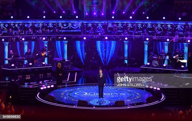 Britain's Prince Harry speaks on stage at The Queen's Birthday Party concert at the Royal Albert Hall in London on April 21 2018 on the occassion of...