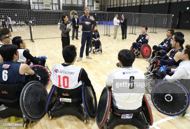 Britains Prince Harry speaks to athletes during his tour of the Japan Foundation's Para Arena in Tokyo on November 2 2019 / Japan OUT