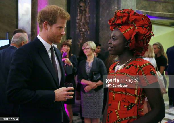 Britain's Prince Harry speaks to guests during the Queen's Young Leaders Awards Dinner at Australia House following an awards ceremony and reception...