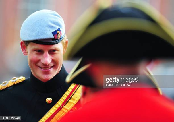 Britain's Prince Harry speaks with Chelsea Pensioners as he reviews the annual Founders Day Parade at the Royal Hospital Chelsea, in London, on June...