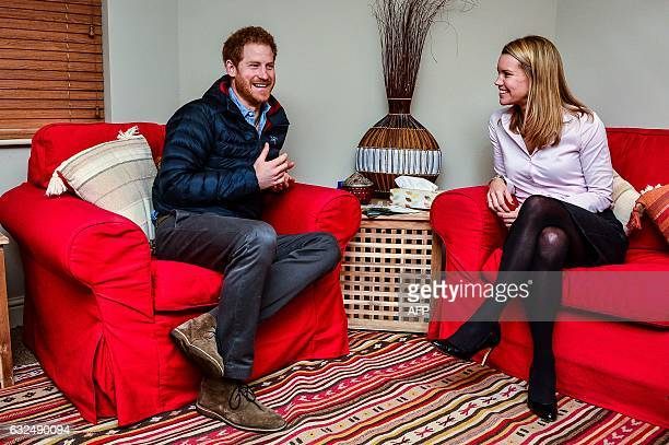 Britain's Prince Harry speaks with speaks with Head of Psychological Wellbeing Vanessa Moutan during a visit to a Help For Heroes Recovery Centre at...
