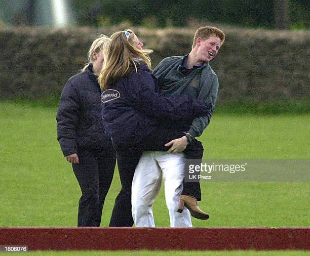 Britain''s Prince Harry spends time with two female friends June 9 2001 at the Beaufort Polo Club near Tetbury in Gloucestershire England