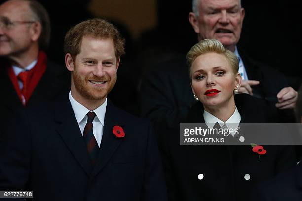 Britain's Prince Harry stands by Princess Charlene of Monaco before the rugby union test match between England and South Africa at Twickenham stadium...